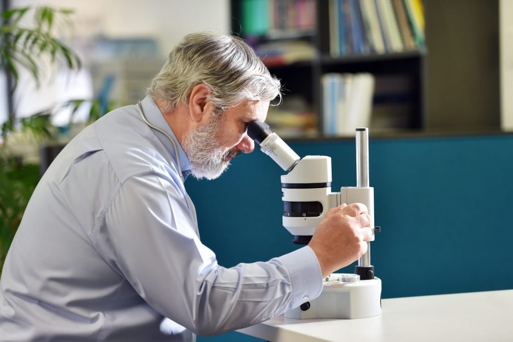 Doctor Researching with Microscope